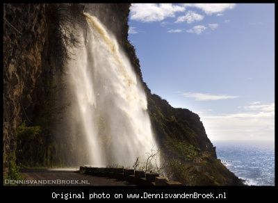 Waterfall over the road at Ponta do Sol